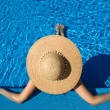Woman at poolside — Stock Photo #22170669