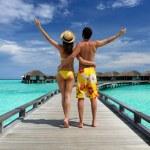 Couple on a beach jetty at Maldives — Stock Photo #22493419
