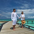 Royalty-Free Stock Photo: Couple on a beach jetty at Maldives