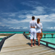 Couple on a beach jetty at Maldives — Stock Photo #22624945