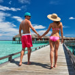 Couple on a beach jetty at Maldives — Stock Photo #22625085
