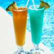 Cocktails near swimming pool - Stock Photo