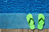 Slippers by a swimming pool — Stock Photo