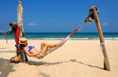 Woman in hammock on beach — Foto de Stock