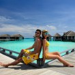 Couple on a beach jetty at Maldives — 图库照片