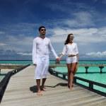 Couple on a beach jetty at Maldives — Stock Photo #23116660