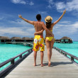 Couple on a beach jetty at Maldives — Stock Photo #23466724