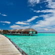 Beautiful beach with water bungalows - Stock Photo