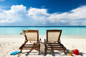 Tropical beach with chaise lounge — Stock Photo