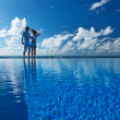Couple at the poolside — Stock Photo