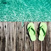 Pantofle na molu — Stock fotografie