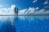 Couple at the poolside — Foto de Stock