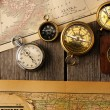 Antique compasses over old map — Stockfoto