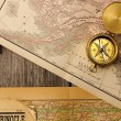 Antique compass over old map — Stok fotoğraf