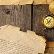 Antique compass over old map - Foto Stock
