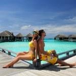 Couple on a beach jetty at Maldives — Stock Photo #24150951