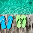 Slippers at jetty - Stock Photo