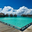Beautiful beach with water bungalows - Zdjcie stockowe