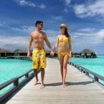 Couple on a beach jetty at Maldives — Stock Photo #24500743