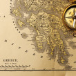 Antique compass over old XIX century map — Stock Photo #24500807