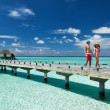 Couple on a beach jetty at Maldives — Stock Photo #24500979