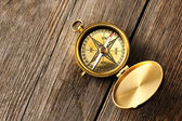 Antique compass over wooden background — Stock Photo