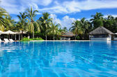 Luxury tropical swimming pool — Stock Photo