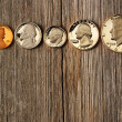 US cent coins over wooden background — Stock Photo #24791215
