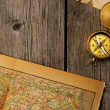 Antique compass over old map — Stock Photo #24791433