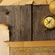 Antique compass over old map — Stock Photo #24791501
