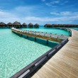 Stock Photo: Beautiful beach with water bungalows