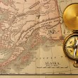 Antique compass over old XIX century map — Stock fotografie