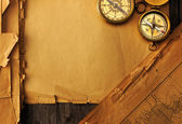 Antique compass over old map — Stock Photo