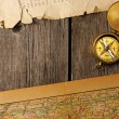 Royalty-Free Stock Photo: Antique compass over old map