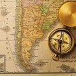 Antique compass over old XIX century map — Stock Photo