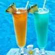 Cocktails near swimming pool - Stockfoto