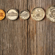 US cent coins over wooden background — Stock Photo #25231447