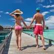 Couple on a beach jetty at Maldives - Stock Photo