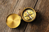 Antique compass over wooden background — Foto Stock