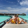 Couple on a beach jetty at Maldives — Stockfoto