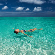 Woman in bikini lying on water — Stock Photo