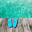 Stock Photo: Slippers at jetty
