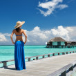 Woman on a beach jetty at Maldives — Stockfoto