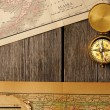 Antique compass over old map — ストック写真