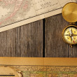 Antique compass over old map — Foto de Stock