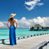 Woman on a beach jetty at Maldives — Stock Photo