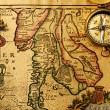 Antique compass over old map — Stock Photo #25970037