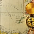 Antique compass over old XIX century map — Stock Photo #25970041