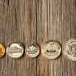 US cent coins over wooden background — Stock Photo #25970067