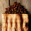 Coffee beans in bag background — Stock Photo